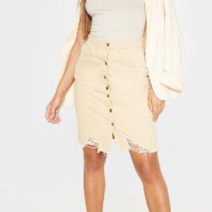 Beige denim distressed skirt